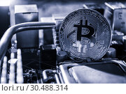 Купить «Silver bitcoin among the electronic computer components. Business concept of digital cryptocurrency, bitcoin mining concept», фото № 30488314, снято 4 апреля 2019 г. (c) Зезелина Марина / Фотобанк Лори