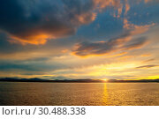 Купить «Summer sunset landscape - sea waters lit by sunset summer light. Summer sunny water scene in colorful tones. Sea summer nature with mountain range at the horizon», фото № 30488338, снято 26 августа 2013 г. (c) Зезелина Марина / Фотобанк Лори