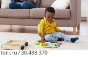 Купить «african american baby boy playing with toy blocks», видеоролик № 30488370, снято 24 марта 2019 г. (c) Syda Productions / Фотобанк Лори