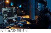 Купить «hacker using computer for cyber attack at night», видеоролик № 30488414, снято 30 марта 2019 г. (c) Syda Productions / Фотобанк Лори