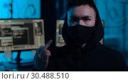 Купить «hacker with computers showing middle finger», видеоролик № 30488510, снято 30 марта 2019 г. (c) Syda Productions / Фотобанк Лори