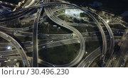 Купить «Aerial view of lighted highway road junctions at night», видеоролик № 30496230, снято 26 октября 2018 г. (c) Яков Филимонов / Фотобанк Лори