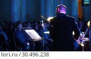 Купить «A man in costume playing drums and looking at notes at the jazz concert. Back view», видеоролик № 30496238, снято 8 июля 2020 г. (c) Константин Шишкин / Фотобанк Лори