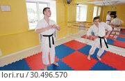 Two athletic men training their aikido skills in the studio. Warming up before training. Стоковое видео, видеограф Константин Шишкин / Фотобанк Лори