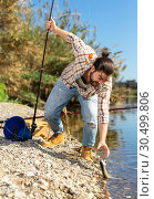 Купить «Happy fisherman pulls fish out of the river», фото № 30499806, снято 15 марта 2019 г. (c) Яков Филимонов / Фотобанк Лори