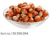 Купить «Glass bowl with hazelnuts», фото № 30500094, снято 20 апреля 2019 г. (c) Яков Филимонов / Фотобанк Лори
