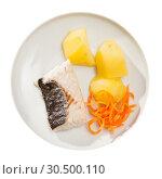 Купить «Top view of steamed hake with potatoes, grated carrot», фото № 30500110, снято 24 апреля 2019 г. (c) Яков Филимонов / Фотобанк Лори