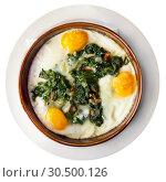 Купить «Top view of fried eggs with spinach, raisins, ham», фото № 30500126, снято 22 апреля 2019 г. (c) Яков Филимонов / Фотобанк Лори