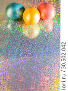 Купить «Easter background. Colored pearl eggs of gold, pink, coral, blue and turquoise on a halo background with a copy space», фото № 30502042, снято 31 марта 2019 г. (c) Светлана Евграфова / Фотобанк Лори