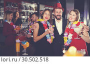 Купить «Man with female friends on Hawaiian party in bar», фото № 30502518, снято 29 ноября 2017 г. (c) Яков Филимонов / Фотобанк Лори