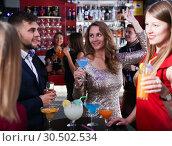 Купить «Woman with friends at nightclub», фото № 30502534, снято 29 ноября 2017 г. (c) Яков Филимонов / Фотобанк Лори