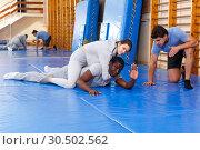Купить «People fighting with coach at gym», фото № 30502562, снято 31 октября 2018 г. (c) Яков Филимонов / Фотобанк Лори
