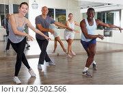 Купить «Group of multinational happy adult people enjoying active dance movement», фото № 30502566, снято 30 июля 2018 г. (c) Яков Филимонов / Фотобанк Лори