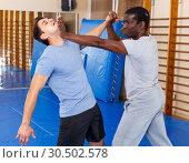 Купить «Two men practicing self defense techniques», фото № 30502578, снято 31 октября 2018 г. (c) Яков Филимонов / Фотобанк Лори