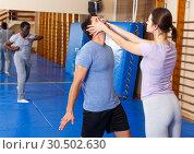 Купить «People practicing self defense techniques», фото № 30502630, снято 31 октября 2018 г. (c) Яков Филимонов / Фотобанк Лори