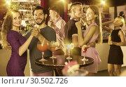 Купить «Young happy women with men are dancing in pairs in the nightclub», фото № 30502726, снято 2 августа 2017 г. (c) Яков Филимонов / Фотобанк Лори