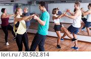 People learning swing at dance class. Стоковое фото, фотограф Яков Филимонов / Фотобанк Лори