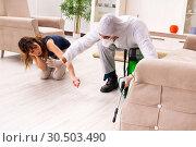 Купить «Young professional contractor doing pest control at flat», фото № 30503490, снято 3 декабря 2018 г. (c) Elnur / Фотобанк Лори