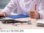Купить «Young male doctor in telemedicine concept», фото № 30504206, снято 7 декабря 2018 г. (c) Elnur / Фотобанк Лори