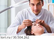 Купить «Young woman visiting male doctor cosmetologist», фото № 30504262, снято 16 ноября 2017 г. (c) Elnur / Фотобанк Лори