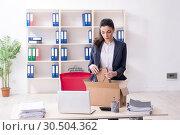 Купить «Young female employee being fired from her work», фото № 30504362, снято 15 января 2019 г. (c) Elnur / Фотобанк Лори
