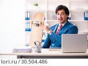 Купить «Young handsome businessman with longboard in the office», фото № 30504486, снято 11 декабря 2018 г. (c) Elnur / Фотобанк Лори