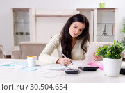 Купить «Young woman with receipts in budget planning concept», фото № 30504654, снято 13 ноября 2018 г. (c) Elnur / Фотобанк Лори