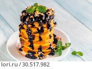 Pumpkin pancakes with chocolate topping. Стоковое фото, фотограф Alex9500 / easy Fotostock / Фотобанк Лори