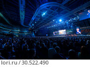People attend business conference in congress hall at Synergy Global Forum (2018 год). Редакционное фото, фотограф Антон Гвоздиков / Фотобанк Лори