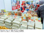 Купить «Russia, Samara, March 2017: Eastern sweets at the fair. Text in Russian: halva sherbet marmalade dairy products», фото № 30522686, снято 17 марта 2017 г. (c) Акиньшин Владимир / Фотобанк Лори