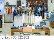 Купить «Russia Samara February 2019: Interior of a youth clothing store.», фото № 30522802, снято 23 февраля 2019 г. (c) Акиньшин Владимир / Фотобанк Лори