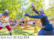 Купить «Russia, Samara, September 2018: Spectacular staged battles of Slavic warriors and knights at the festival in Zagorodny Park.», фото № 30522854, снято 16 сентября 2018 г. (c) Акиньшин Владимир / Фотобанк Лори