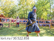 Купить «Russia, Samara, September 2018: Spectacular staged battles of Slavic warriors and knights at the festival in Zagorodny Park.», фото № 30522858, снято 16 сентября 2018 г. (c) Акиньшин Владимир / Фотобанк Лори