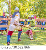Купить «Russia, Samara, September 2018: Spectacular staged battles of Slavic warriors and knights at the festival in Zagorodny Park.», фото № 30522866, снято 16 сентября 2018 г. (c) Акиньшин Владимир / Фотобанк Лори