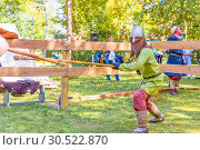 Купить «Russia, Samara, September 2018: Spectacular staged battles of Slavic warriors and knights at the festival in Zagorodny Park.», фото № 30522870, снято 16 сентября 2018 г. (c) Акиньшин Владимир / Фотобанк Лори
