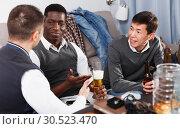 Купить «Males friendly meeting over beer», фото № 30523470, снято 23 февраля 2018 г. (c) Яков Филимонов / Фотобанк Лори