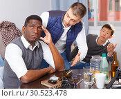 Купить «Chagrined man with friends», фото № 30523478, снято 23 февраля 2018 г. (c) Яков Филимонов / Фотобанк Лори