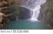 Купить «Oniore Waterfall in Georgia», видеоролик № 30526666, снято 10 марта 2019 г. (c) Serg Zastavkin / Фотобанк Лори