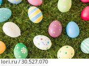 Купить «colored easter eggs on artificial grass», фото № 30527070, снято 15 марта 2018 г. (c) Syda Productions / Фотобанк Лори