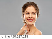 Купить «smiling young woman over grey background», фото № 30527218, снято 20 января 2019 г. (c) Syda Productions / Фотобанк Лори