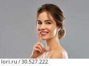 Купить «beautiful smiling woman making hush gesture», фото № 30527222, снято 20 января 2019 г. (c) Syda Productions / Фотобанк Лори