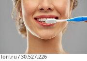 Купить «close up of woman with toothbrush cleaning teeth», фото № 30527226, снято 20 января 2019 г. (c) Syda Productions / Фотобанк Лори