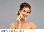 Купить «young woman cleaning face with exfoliating sponge», фото № 30527234, снято 20 января 2019 г. (c) Syda Productions / Фотобанк Лори