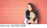 Купить «happy smiling teenage girls or friends hugging», фото № 30527254, снято 19 декабря 2015 г. (c) Syda Productions / Фотобанк Лори