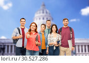 Купить «students showing thumbs up over capitol building», фото № 30527286, снято 10 ноября 2018 г. (c) Syda Productions / Фотобанк Лори
