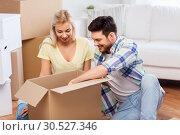Купить «happy couple unpacking boxes at new home», фото № 30527346, снято 25 февраля 2016 г. (c) Syda Productions / Фотобанк Лори