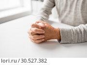 Купить «senior man hands on table», фото № 30527382, снято 7 июля 2016 г. (c) Syda Productions / Фотобанк Лори