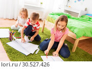 Купить «children drawing and making crafts at home», фото № 30527426, снято 15 октября 2017 г. (c) Syda Productions / Фотобанк Лори