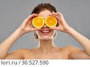 Купить «smiling woman with oranges over grey background», фото № 30527590, снято 20 января 2019 г. (c) Syda Productions / Фотобанк Лори