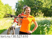 Купить «happy young man with bicycle outdoors in summer», фото № 30527610, снято 5 июля 2015 г. (c) Syda Productions / Фотобанк Лори